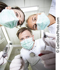 Dentist and nurses from low angle view