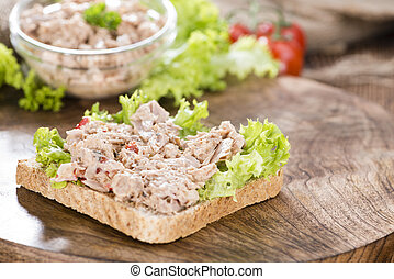 Slice of bread with Tuna salad (on wooden background)