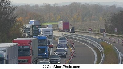 Traffic on german Autobahn, Cars and Trucks. flat CineD...