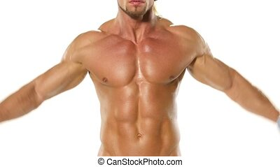 Young bodybuilder athlete trains muscles closeup on white...