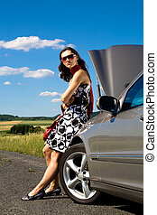 woman by broken down car - young woman standing beside a...