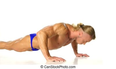 Handsome muscular man doing push-up on white background.
