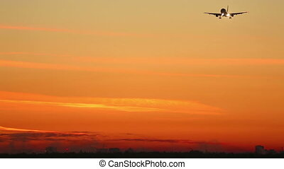 Morning approach - Jet airliner approaching airport at dawn.