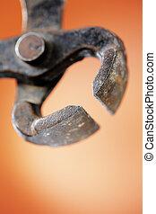 Pincer - Old worn metallic carpenter\'s pincer in closeup....