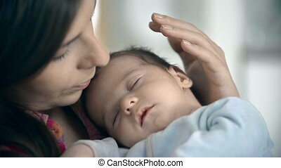 Sweet Sleep - Little boy sleeping in maternal