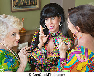 Talking and Smoking Women - Group of three 1960s style women...