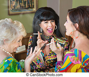 Laughing Middle Aged Women Smoking - Laughing group of three...
