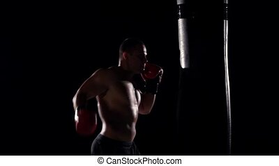 boxer man during boxing hiting heavy bag at training fitness...