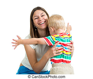 Young mother hugging kid son isolated on white