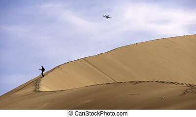 Hexacopter Over the Dunes - Traveller rises to a high dune....