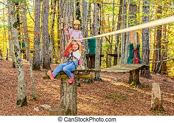 Zip line fun - Little girls are going on the zip line