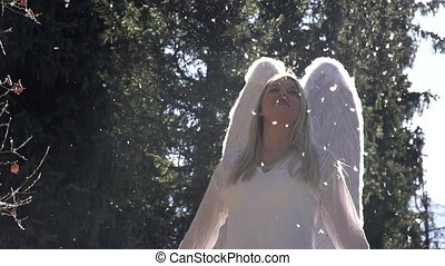 Angel Wings Beat - Blonde girl in a white dress with angel...