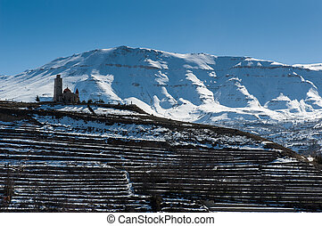 Old church on snowy mountains of Lebanon