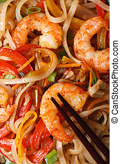 rice noodles with shrimp macro vertical view from above -...