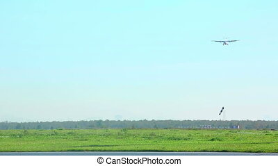 Landing - Turboprop aircraft descending into airport