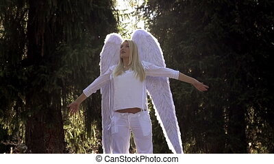 Girl in White with Angel Wings - Blonde girl in a white...