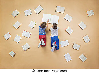 Children with books - Happy children are reading book on the...