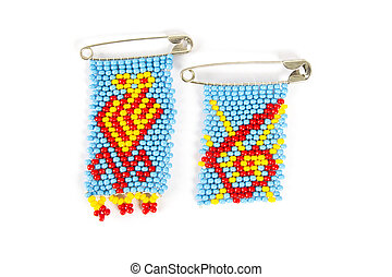 African bead work - Two brooches of African bead work on a...
