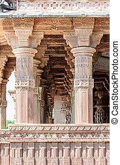 Ancient rock curved temples of Hindu Gods and godess at...