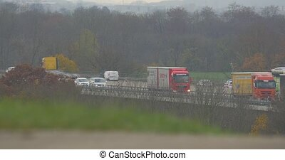 Traffic on german Autobahn, Cars and Trucks flat CineD...