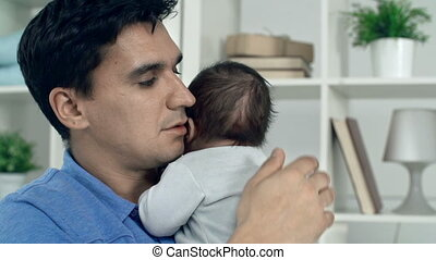 Affectionate Father - Portrait of handsome father caressing...