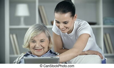 Care Center - Nurse and patient laughing together at...