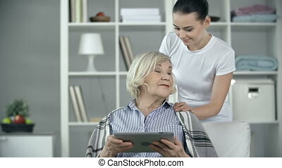 Comfortable Aging - Elderly patient asking young nurse to...