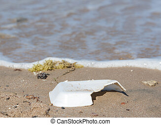 Rubbish on sandy beach - Closeup of polystyrene rubbish on...