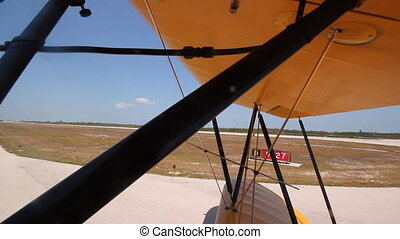 Biplane taxiing before takeoff - Shot from front cockpit of...