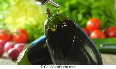 pouring olive oil over an eggplant - eggplants and olive oil...