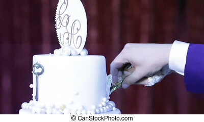 Wedding cake with initials - Cutting wedding cake with...