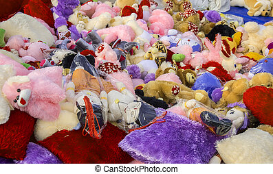 Soft toys on sale. The soft toys have been stacked and piled...