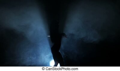 Dancing silhouettes of woman in a nightclub.