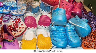 Colorful shoes on sale at a shop.