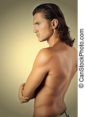 Athlete - Young and sexy brunet male athlete isolated on...