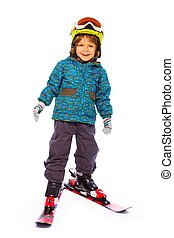 Boy wearing skies stands on white background - Small cute...