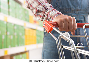 Man in dungarees at supermarket