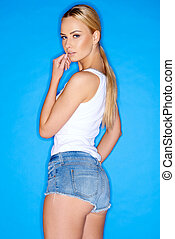 Woman in Sleeveless Shirt and Denim Mini Shorts - Quarter...