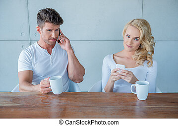 Sitting Couple Having Coffee with Mobile Phones - White...