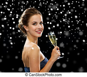 smiling woman holding glass of sparkling wine - people,...