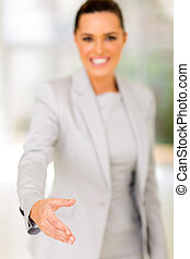 businesswoman offering handshake in office
