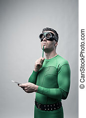 Superhero thinking with green pencil - Green superhero...