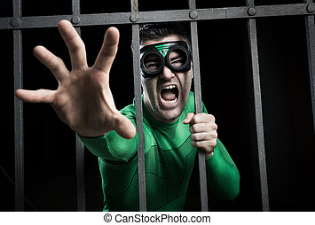 Superhero locked in prison - Angry green superhero shouting...