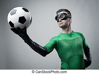 Superhero with soccer ball