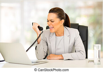 young businesswoman screaming at telephone