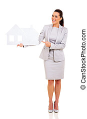 business woman pointing paper house - cheerful business...