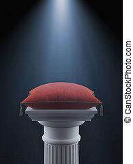 White column with red velvet pillow