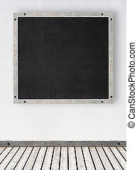 white stucco wall with chalkboard