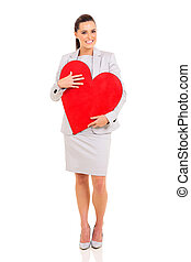 young businesswoman with red heart shape - lovely young...