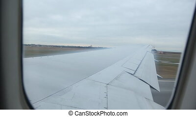 Condensation wings. - Flying out of Vancouver, BC. Water...